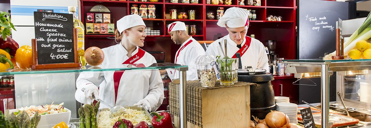Sodexo chefs preparing food behind a counter